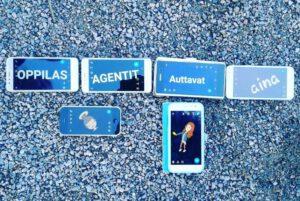Kuusi kännykkää asvaltilla, näytöillä teksti OppilasAgentit auttavat aina